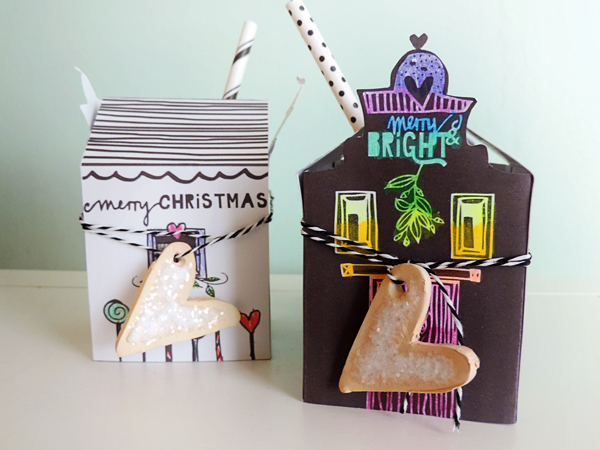 Cookie Boxes by Amy Kingsford | Supplies: Printables, Cut files and Tutorial by Wilna Furstenberg of iHeart Studio; 3d Box Cut File by Lori Whitlock; Cardstock, Glitter, Crayola Twistable Crayons, Tacky Glue, Twine, Paper Straws, Oven Bake Clay.